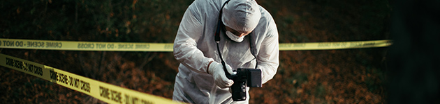 Forensic scientist taking photos at a crime scene