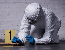 Forensic scientist collecting blood from a crime scene