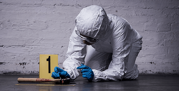 Forensic Medicine Education Program scientist collecting blood from a crime scene